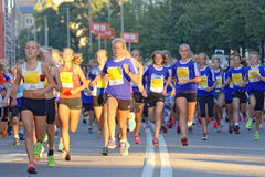 Group of running girls and boys Stock Photos