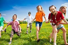 Group of running kids Stock Photo
