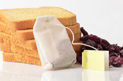 Group of rusks, berries and a tea bag Royalty Free Stock Images