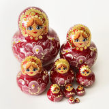 A Group of Russian Wooden Dolls. A Group of Russian Dolls on a White Background stock images