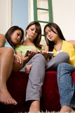 Group of sad girls and a book #2 - People Series Royalty Free Stock Image