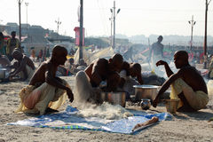 A group of Sadhus make food at Kumbh Mela Stock Photo