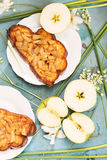 Group of sandwiches and apples with white flowers on blue table Royalty Free Stock Photos