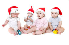 Group of santa babies Stock Photos