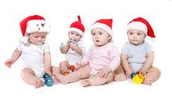 Group of santa babies. Over white Stock Photos