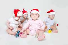 Group of santa babies. Over white Royalty Free Stock Image