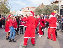 Group of Santa Clauses entertains participants of annual Christm Royalty Free Stock Image