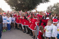 Group of Santa Clauses entertains participants of annual Christm Stock Images