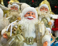 Group of Santa Clauses with gifts Royalty Free Stock Images