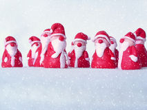 A group of santas in the snow Stock Image