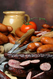 Group of sausages on holiday table with  knives Stock Photo