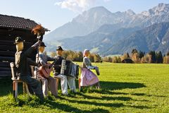 Group of scarecrows. In female dress standing on a field, Austria Stock Images
