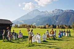 Group of scarecrows. In female dress standing on a field, Austria Stock Photography
