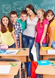 School child sitting in classroom. Group of school child sitting on desk in classroom stock photo