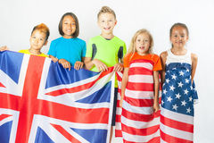 Group of school children holding american national flag Stock Images