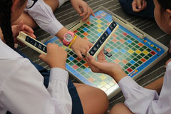 A Group of School Children Playing Math Scrabble Royalty Free Stock Photos