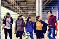Group of school friends outdoors lifestyle and leisure music concept royalty free stock images