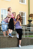 Group of school girls calling on the cell phones Royalty Free Stock Photo