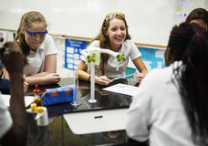 Group of school girls learning science class. School girls learning science class Royalty Free Stock Images