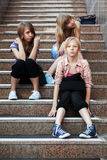Group of school girls sitting on the steps Stock Image