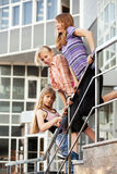 Group of school girls on the steps Royalty Free Stock Images
