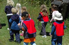 Group of school kids. Watching nature outside and walking outdoors in the forest Stock Images