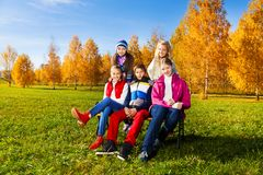 Group of school kids in autumn park Royalty Free Stock Photo