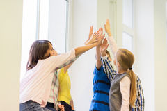 Group of school kids making high five gesture Stock Photography