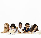Group of school kids reading for education stock photo
