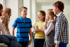 Group of school kids with soda cans in corridor Royalty Free Stock Photography