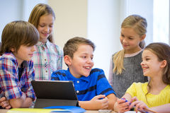 Group of school kids with tablet pc in classroom Royalty Free Stock Photos