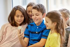Group of school kids taking selfie with smartphone Stock Images
