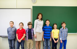 Group of school kids and teacher in classroom Stock Photography