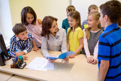Group of school kids with teacher in classroom Stock Photography