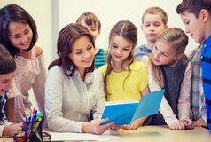 Group of school kids with teacher in classroom Royalty Free Stock Photography