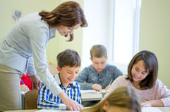 Group of school kids writing test in classroom Royalty Free Stock Photo