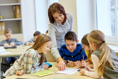 Group of school kids writing test in classroom royalty free stock photos