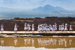 Group of school students visiting Sigiriya complex Royalty Free Stock Photography
