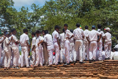 Group of school students visiting Sigiriya complex Stock Photo