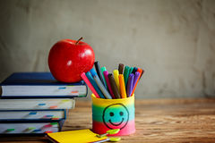 Group of school supplies and books and red apple over on background.School, stationary, equipment. Royalty Free Stock Image