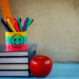 Group of school supplies and books and red apple over on background.School, stationary, equipment. Stock Photo