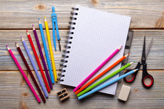Group of school supplies on wooden planks Stock Photo