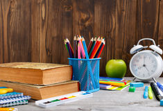 Group of school supplies on wooden table Royalty Free Stock Photos