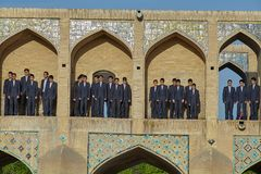 A group of schoolboy on Khaju bridge in Isfahan, Iran. Isfahan, Iran - April 24, 2017: A group of schoolchildren prepares for choral singing at a city holiday stock photo