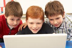 Group Of Schoolboys In IT Class Using Computer Stock Photography