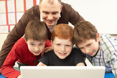 Group Of Schoolboys In IT Class Using Computer Royalty Free Stock Photo