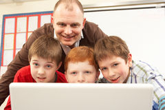 Group Of Schoolboys In IT Class Using Computer Stock Images