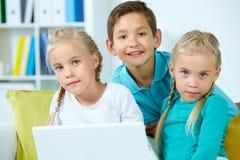 Group of schoolchildren Stock Images