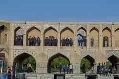 A group of schoolchildren on Khaju bridge in Isfahan, Iran. Isfahan, Iran - April 24, 2017: A children`s choir of boys of school age lined up in the arched stock images