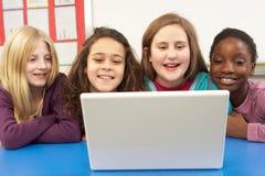 Group Of Schoolgirls In IT Class stock images
